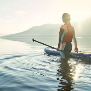 Paddle Boarder on Water with sunshine